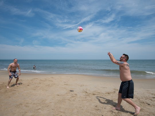 Marc Smith, right of Lewes plays beach volleyball with a friend at Rehoboth Beach.