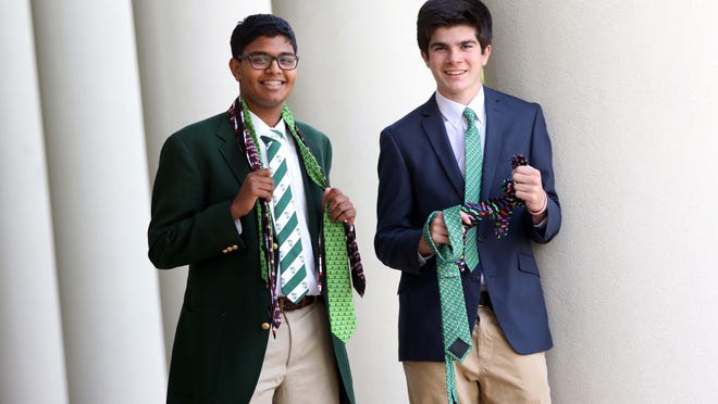 Left to right Shreyas Parab, 15, and his classmate Joe DiGregorio, 15, both sophomores at Archmere Academy, show off some of the novelty ties that Parab created as the CEO of NovelTie and DiGregorio, has marketed as the director of sales for the ties.