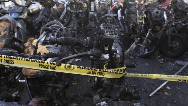 Burnt motorcycles are seen at one of the sites of the church attacks in Surabaya, East Java, Indonesia, Sunday, May 13, 2018. Suicide bombers carried out deadly attacks on three churches in Indonesia's second-largest city on Sunday, killing at least 13 people and woundin dozens. (AP Photo)
