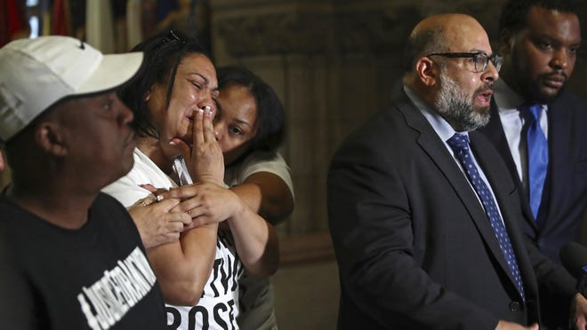 FILE – In this June 27, 2018, file photo, Michelle Kenney, second from left, the mother of Antwon Rose Jr., reacts and Antwon Rose, left, the boy's father, listens as attorney Fred Rabner, second from right, speaks to reporters at the Allegheny County Courthouse in Pittsburgh. The fatal police shooting of Antwon Rose Jr. as he fled during a traffic stop on June 19, is the first in the Pittsburgh area in the Black Lives Matter era, and it is galvanizing residents who say they've been frustrated for too long. (Harrison Jones/Pittsburgh Tribune-Review via AP, File)