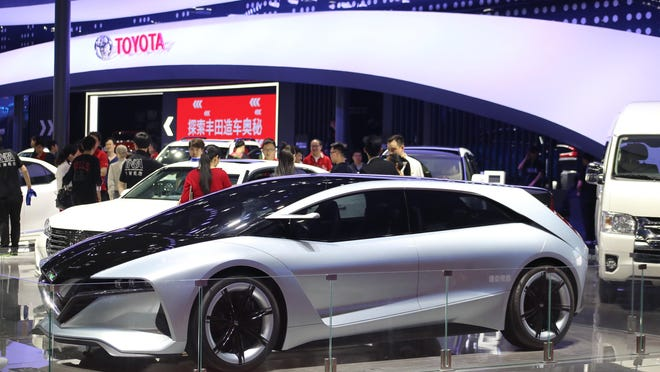 Toyota, exhibiting above in Shanghai, seeks to build 3.5 million vehicles annually in China by 2030.