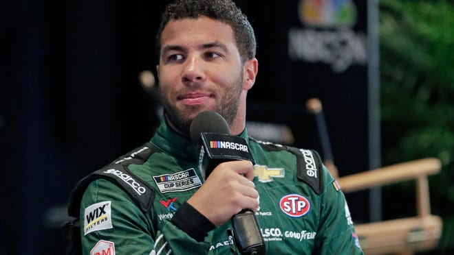 FILE - In this Feb. 12, 2020, file photo, Bubba Wallace takes part in an interview during NASCAR Daytona 500 auto racing media day at Daytona International Speedway in Daytona Beach, Fla. Corporate interest in Bubba Wallace has picked up momentum and NASCAR's only black full-time driver has signed a new sponsor that includes funding for his Richard Petty Motorports team. Columbia Sportswear signed a multiyear sponsorship with Wallace as a brand ambassador that will also put the company on the No. 43 at Dover later this month.