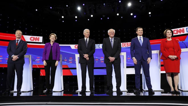 DES MOINES, Iowa -- From left, Democratic presidential candidates businessman Tom Steyer, Sen. Elizabeth Warren, D-Mass., former Vice President Joe Biden, Sen. Bernie Sanders, I-Vt., former South Bend Mayor Pete Buttigieg, and Sen. Amy Klobuchar, D-Minn., stand on stage on January 14, before a Democratic presidential primary debate hosted by CNN and the Des Moines Register.
