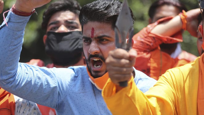 Activists of Hindu Bajrang dal protest against Chinese president Xi Jinping during a protest against China in Jammu, India, Wednesday, June.17, 2020. twenty Indian soldiers including a Colonel were martyred and several others injured in the deadly clash with Chinese soldiers, who also faced heavy casualties.