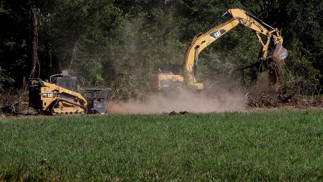 Forsgren heavy equipment operators clear the Manes and Miracles' Chaffee Crossing property, Monday, August 3, 2020, allowing the therapy horse riding program for special needs to move forward with the Community Christmas Card Fencing Project.