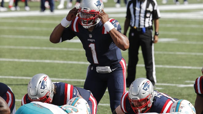 New England Patriots quarterback Cam Newton calls out signals at the line of scrimmage during Sunday's game against the Miami Dolphins at Gillette Stadium.