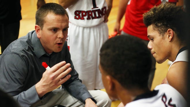 Palm Springs Head Coach Chris Howard talks to his team during a timeout as Indio visits Palm Springs in a boys basketball game Thursday, January 9, 2014