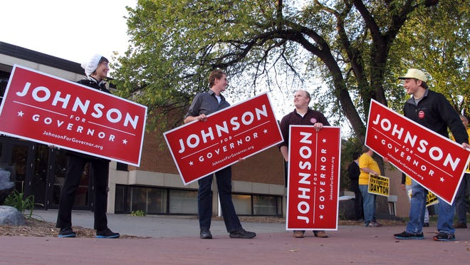 Supporters for Minnesota Republican governor candidate Jeff Johnson, from left, Janine Hanson, Liam Nuhring, Nate LaCombe and Jake Johnson, all from Moorhead, Minn., stand outside a Concordia College auditorium