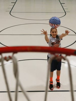 East Point Elementary School sixth-grader Tori Perez practices her free-throw shooting. Tori will compete in the Elks Club Hoop Shoot Competition in Dallas this month.