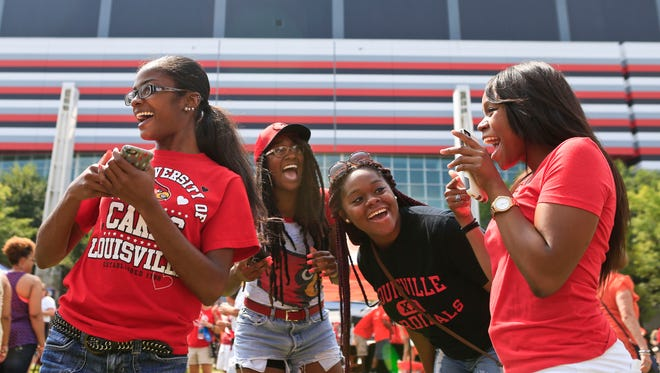 Louisville fans have fun outside the Georgia Dome before the Auburn game Saturday morning. Sept. 5, 2015