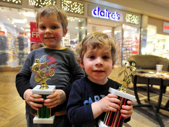Gibson and Sawyer Franks show off the trophies they earned at the Electric City BMX Strider Day event on Saturday in the Holiday Village Mall.