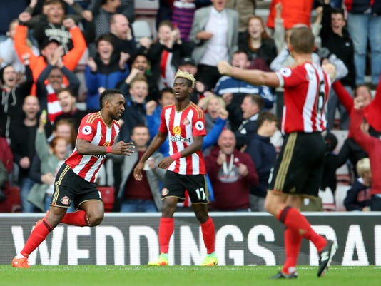 Sunderland's Jermain Defoe, left, celebrates after scoring his second goal against Crystal Palace's during their English Premier League soccer match at The Stadium of Light, Sunderland, England, Saturday Sept. 24, 2016. (Scott Heppell/ PAvia AP)