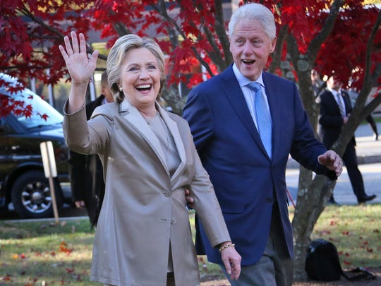 Democratic presidential candidate Hillary Clinton, and her husband former President Bill Clinton, greet supporters after voting in Chappaqua, N.Y., Tuesday, Nov. 8, 2016.