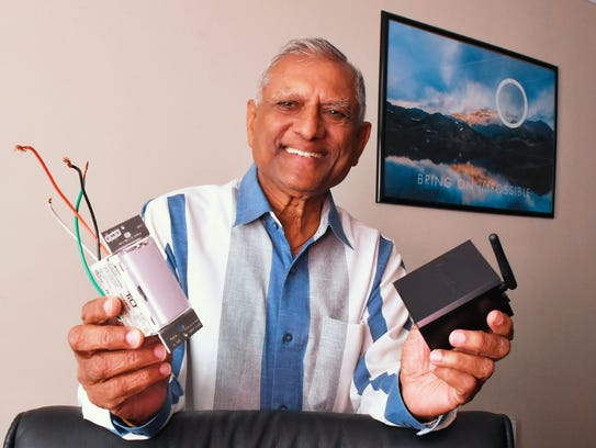 Vinu Patel, chairman of TiO, showing the TouchLite4 (TL4), and the StealthStream 1 (SS1).