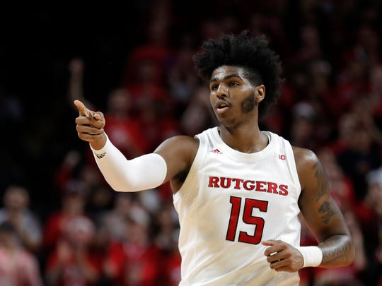 Rutgers center Myles Johnson (15) reacts after making a basket during the first half of an NCAA college basketball game against Nebraska on Saturday, Jan. 25, 2020, in Piscataway, N.J. (AP Photo/Adam Hunger)