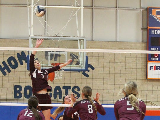 Bronte High School's Bryton Pearcy goes up for an attack against Klondike during the Region I-1A volleyball tournament Saturday, Nov. 11, 2017, at Babe Didrikson Gym at Central High School.