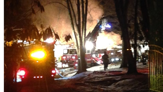 A three-alarm fire in Bedford Hills gutted a 3,000-square foot ranch house early Saturday, March 15, 2014 morning, burning for hours and injuring several firefighters, including one who was briefly trapped after the home's roof collapsed.