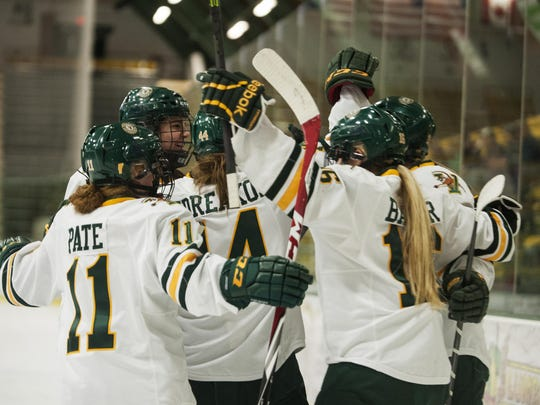 The Catamounts celebrate a goal during the women's