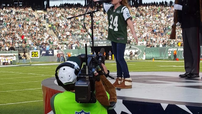 Brianna Collichio, 11, of Spencerport sings the national anthem at Metlife Stadium on Dec. 13 before a New York Jets game. She is scheduled to sing the anthem before Sunday's Bills-Jets game there as well.