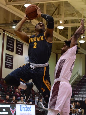 Howard Payne's Khyce Randall goes up for a layup over McMurry's Zacc Carter during the War Hawks' 83-80 win Tuesday at Kimbrell Arena.