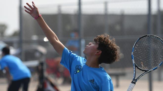 Pueblo West High School sophomore Guy Cruz readies for a serve during he and his No. 1 doubles partner Alec Cruz's 6-3, 6-1 victory over Pueblo County's Seth Sherwood and Bryce Vigil on Aug. 25 at Pueblo West.