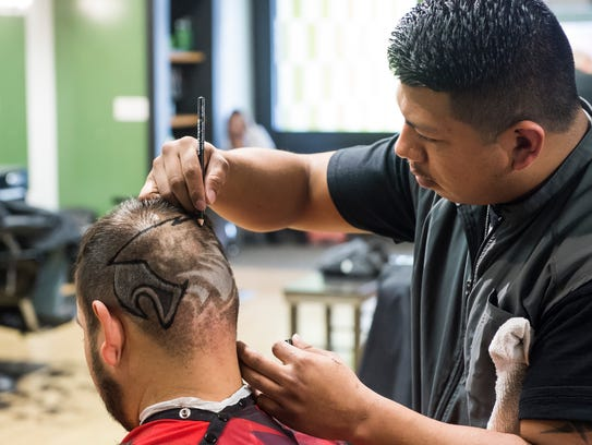 Fidel Ramirez, of Diversified Cuts in Hanover, touches