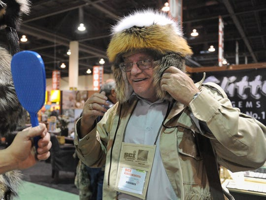 Derald Dixon of Canada tries on a fur hat at the 2010 Safari Club International's annual convention at the Reno-Sparks Convention Center on Jan. 20, 2010.