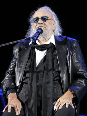 Singer Demis Roussos performs on stage at Istiqlol Palace on October 9, 2012 in Tashkent, Uzbekistan.