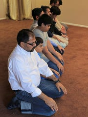 Southern Utah Muslims pray together in July at the