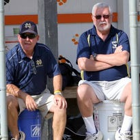 Notre Dame head coach Steve Weber, left, sits with assistant coach Bruce McMail during ta game in 2015.