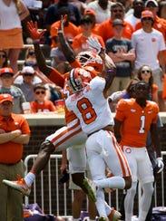 Clemson wide receiver Tee Higgins (5) attempts to catch