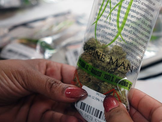 A customer inside the Medicine Man marijuana store