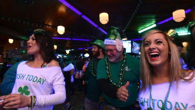 St. Patrick's Day revelers enjoy a laugh inside Morley Hall at Seacrets in Ocean City Saturday, March 14, 2015.