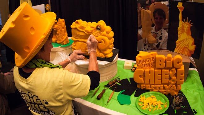 Sarah Kaufmann carves cheddar at last year's Big Cheese Festival.