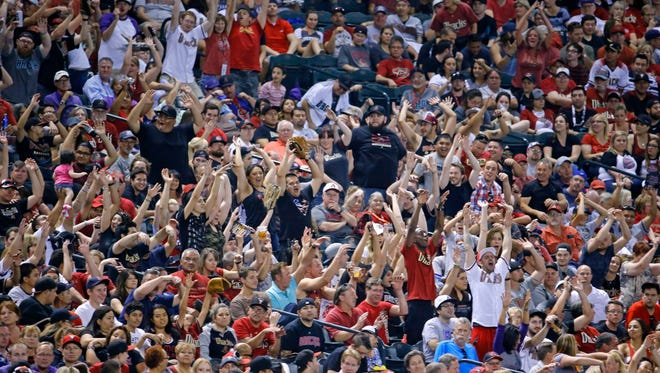 Baseball fans cheer for the Arizona Diamondbacks  as they host the Colorado Rockies in their MLB game Monday, April 24, 2016 at Chase Field Phoenix, Ariz.