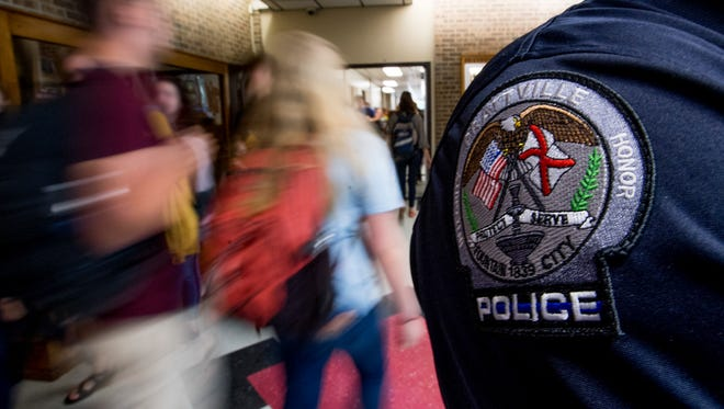Prattville Police Department Sgt T.R. Hope, the school resource officer at Prattville High School, keeps an eye on things at the school in Prattville, Ala. on Tuesday April 3, 2018.