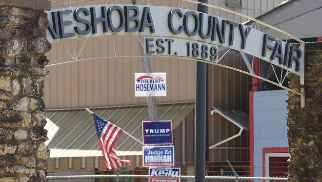 Flags and political signs are shown in this 2016 photo at the Neshoba County Fair.