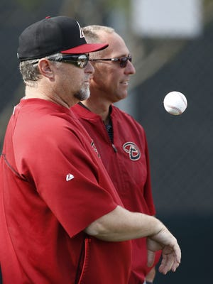 Phil Nevin talks to scouting director Deric Ladnier (right) at spring training practice on Tuesday, Feb.24, 2015 in Scottsdale, AZ.