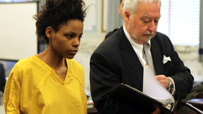De'asia Watkins and her attorney, public defender Norm Aubin, appeared at  her arraignment for decapitating her own child.