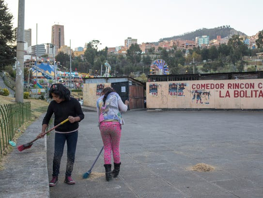 Two girls clean up outside the Jaime Laredo Outdoor