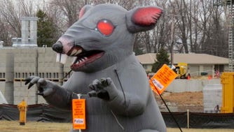 A labor union's display of large a inflatable rat and cat in a street median in Grand Chute has sparked a First Amendment legal fight.