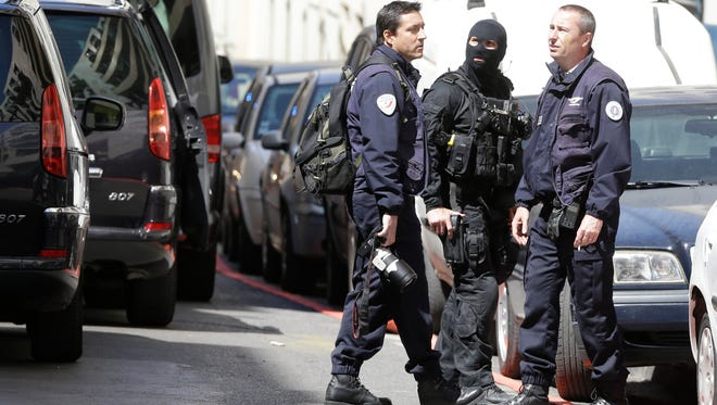 Police officers cordon off a street during searches in Marseille, southern France, Tuesday, April 18, 2017.