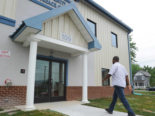 Pastor Will Grimes from Solid Rock Baptist Church enters the church's new community center on North West Street in Dover.