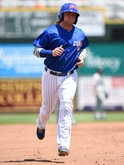 Taylor Davis trots around the bases at Principal Park after a 2015 home run.