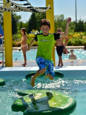 Ankeny resident Franco Gupiettez, 9, runs the water obstacle course on Thursday, July 21, 2016, at the Prairie Ridge Aquatic Center.