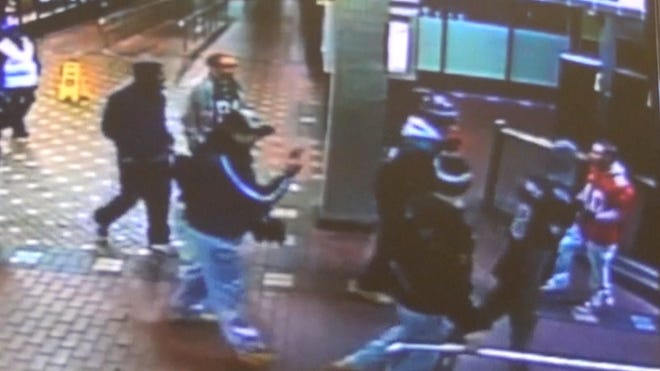 SEPTA surveillance footage captured a dust-up after Monday Night Football in Philly that ended with an Eagles fan punching a Giants fan.