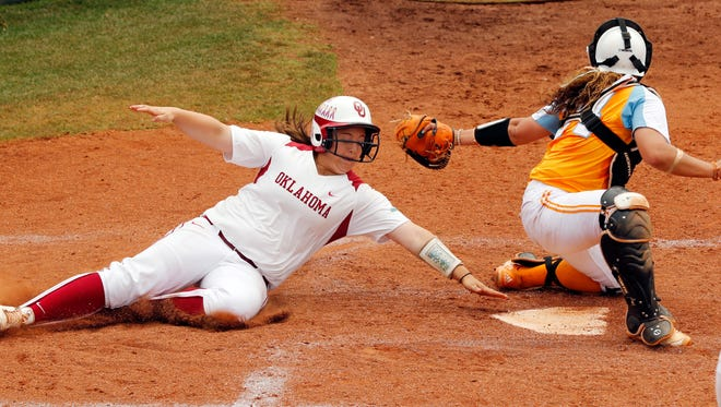 Oklahoma's Brittany Williams misses home plate and a tag by Tennessee's Annie Aldrete but recovers to score as Oklahoma plays Tennessee in game three of the NCAA super regional at Marita Hynes Field on Sunday, May 25, 2014 in Norman, Okla.  (AP Photo/The Oklahoman, Steve Sisney)