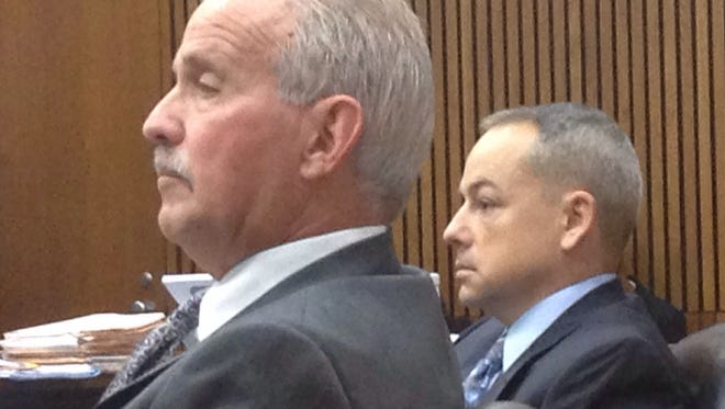 Detroit police officer Joseph Weekley, 38,  right,  sits in court at Frank Murphy Hall of Justice Thursday, Sept. 18, 2014.