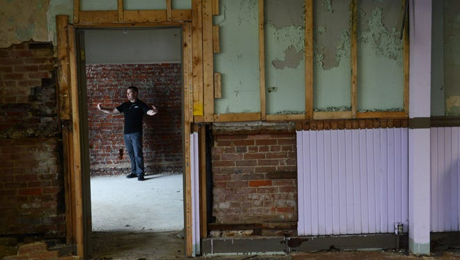 Matt Hart discusses his plans for the former Farmers & Merchants National Bank in Onley, Va. on Wednesday, Dec. 30, 2015. Hart is renovating the building and plans to open a coffee shop at the location. The building was built in 1904.