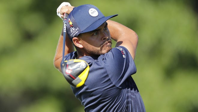 Rickie Fowler hits from the 18th tee during the first round of the Rocket Mortgage Classic golf tournament on Thursday.